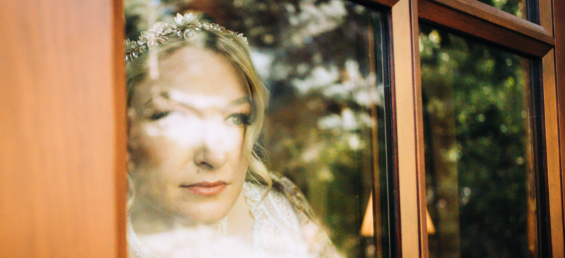 Sarah through the glass, anticipating the day