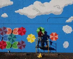 Friend painting the mural