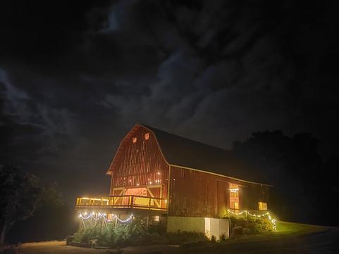 Barn lit up at night