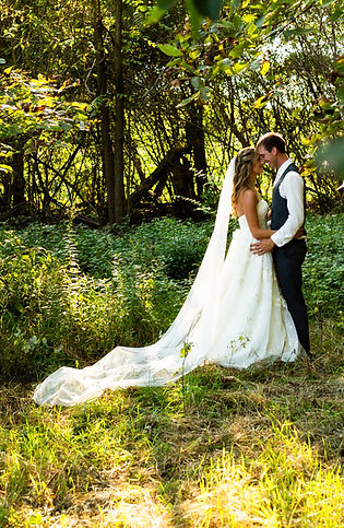 Newlyweds Share A Loving Moment With Rustic Wooded Background