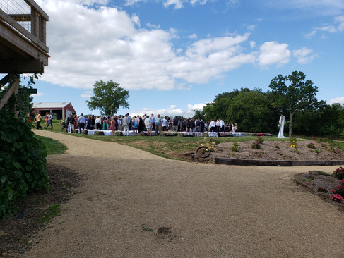 Path view of outdoor ceremony