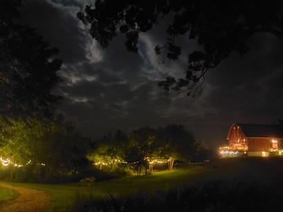 Path and barn at night