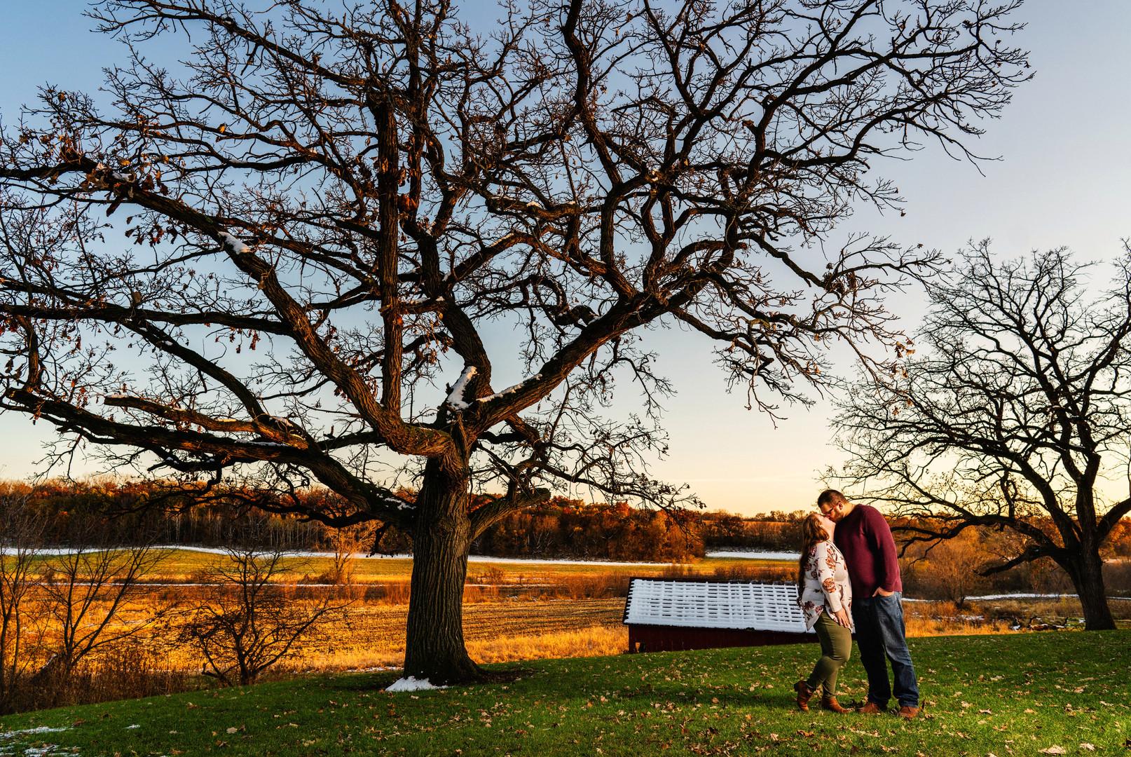 Couple Kiss on Outdoor Wedding Site