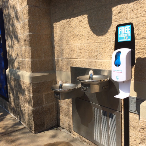 Sunstation sunscreen dispenser at public pool