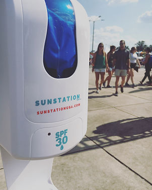 Sunscreen Dispenser by Sunstation USA at outdoor music venue