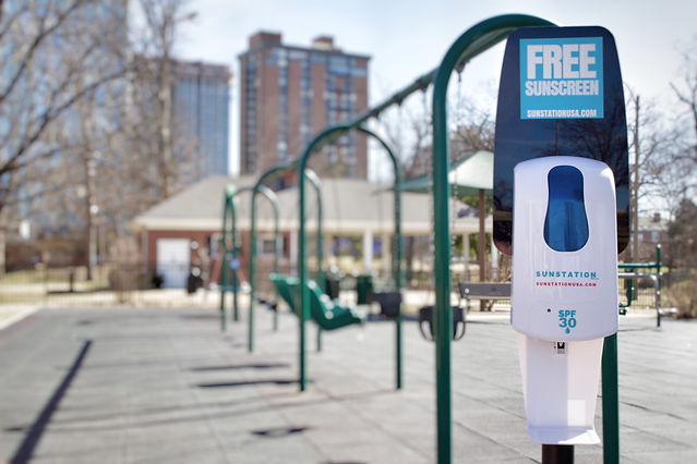 Sunscreen Dispenser by Sunstation USA at school playground - sun safety