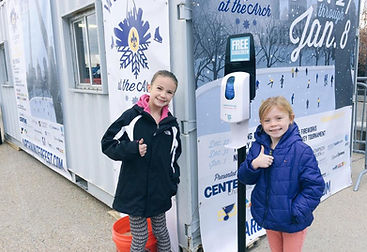 Sunscreen Dispenser by Sunstation USA at ic skating rink - Winterfest