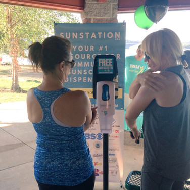 Sunstation USA Sunscreen Dispenser at local 5K run