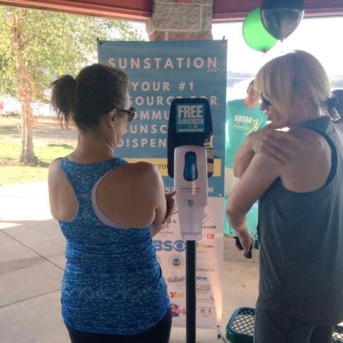 Sunstation USA Sunscreen Dispenser at local 5K run