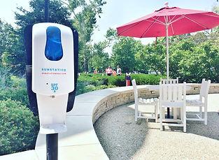 Sunscreen Dispenser by Sunstation USA on outoor pavillio