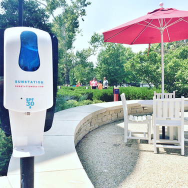 Sunstation sunscreen dispenser at city park