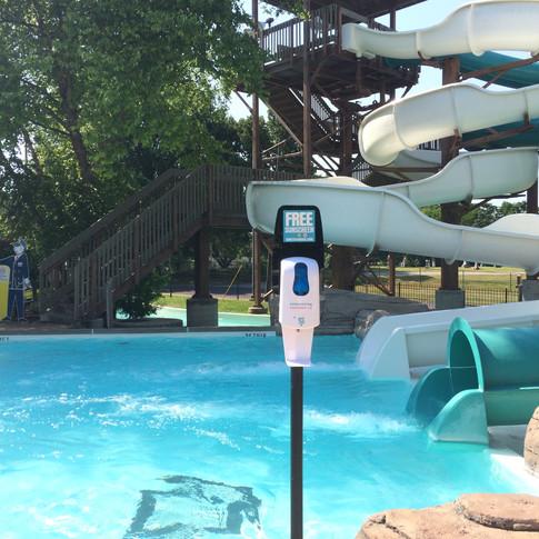 Sunstation USA Sunscreen Dispenser at swimming pool