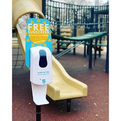 public sunscreen dispenser, community sunscreen dispensers, sunscreen dispenser at park, outdoor sunscreen dispenser, free sunscreen dispenser