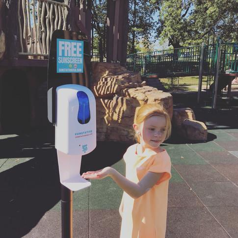 Sunstation sunscreen dispenser at community park