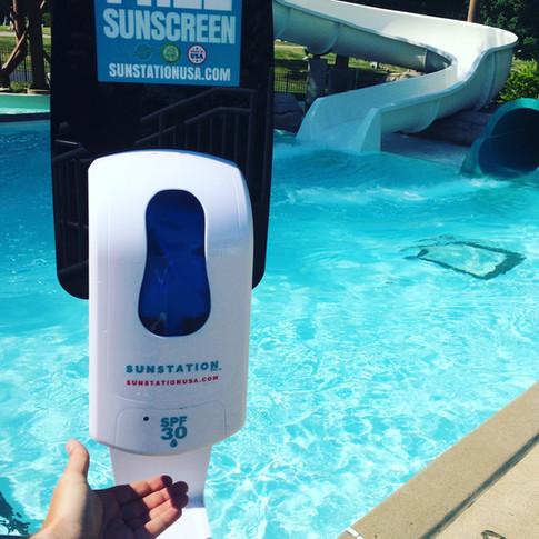 Sunstation USA Sunscreen Dispenser at pool