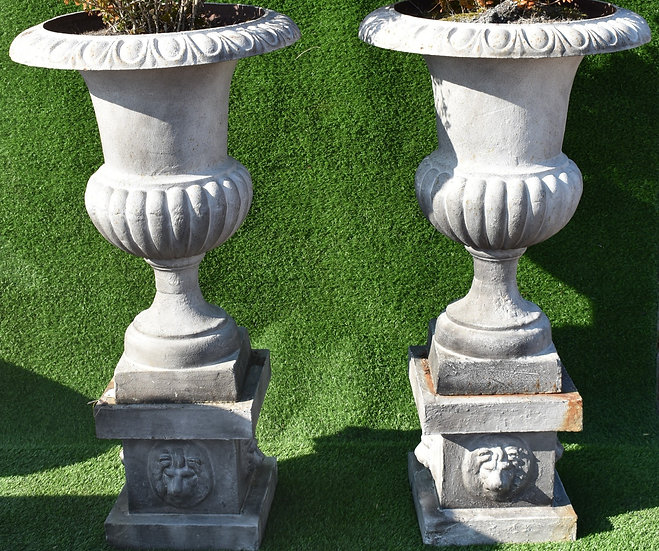 A Pair of Late Victorian Cast Iron Urns