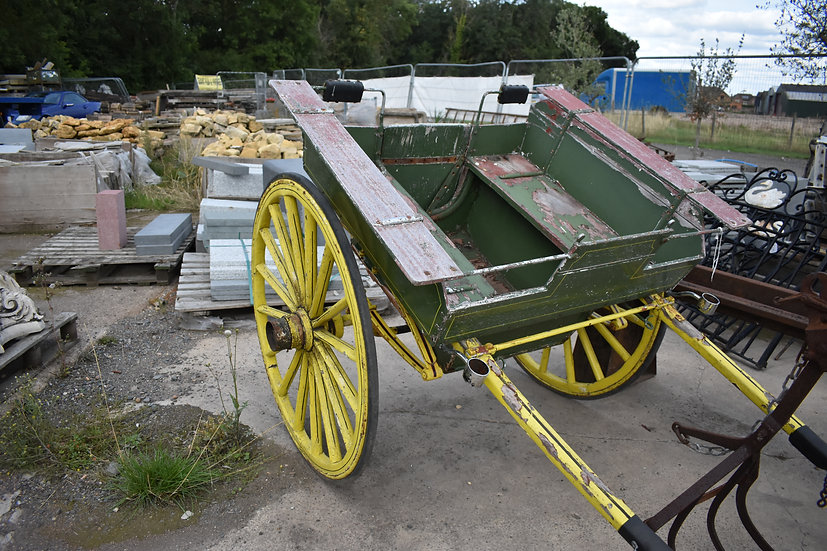 Vintage decorative green cart with yellow wheels