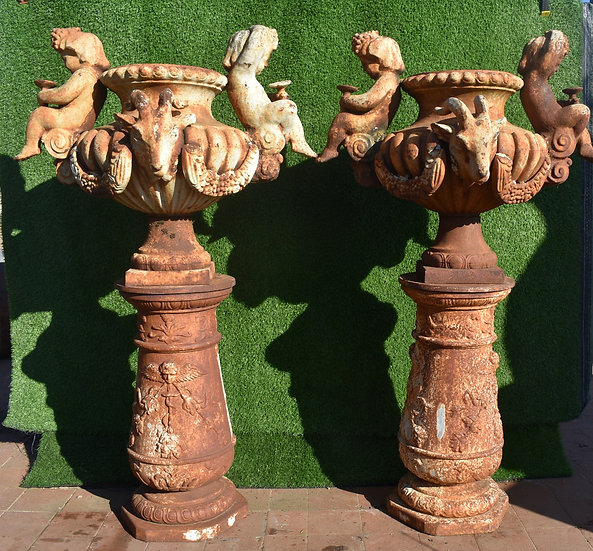 A Pair of Ornate Cast Iron Urns