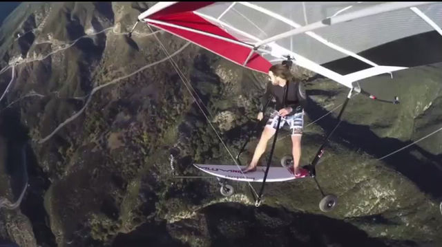 Video: Strapping a surf board to a hang glider