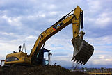 excavators-construction-vehicle-site-con