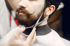 stylish-man-sitting-in-barbershop.jpg