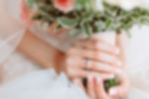 Wedding bouquet of flowers in brides' ha