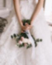 Bridal Bouquet In Brides Hands. Bride in