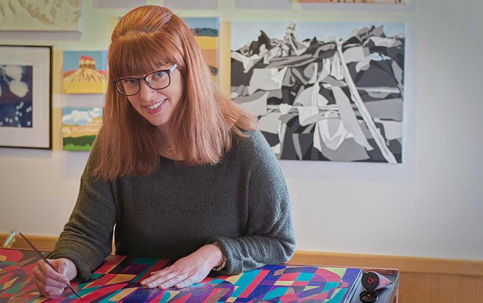 Artist Amanda Porter working on an acrylic painting.