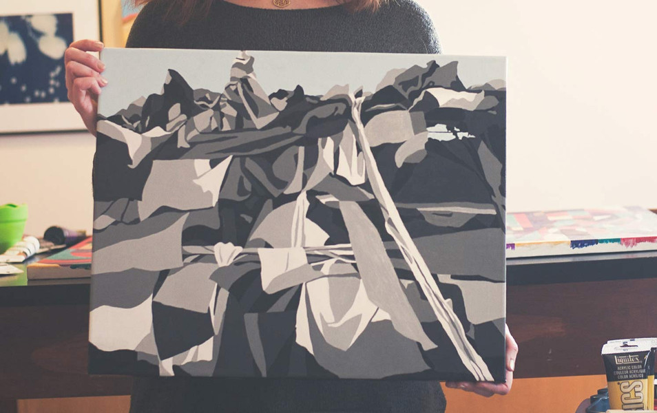 Artist Amanda Porter holding Mountain of Flags.