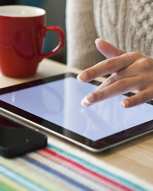 women hands with tablet computer and pho