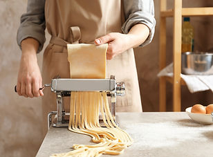 Young woman preparing noodles with pasta