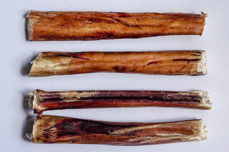Four chew bully sticks. Dried beef pizzl
