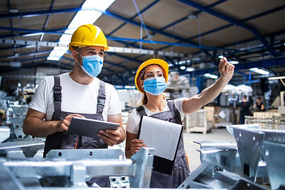 factory-workers-with-face-masks-protected-against-corona-virus-doing-quality-control-of-pr