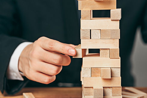 man-and-wooden-cubes-on-table-management