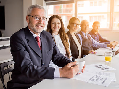 smiling-senior-manager-with-his-colleagues-sitting-together-in-the-meeting.jpg