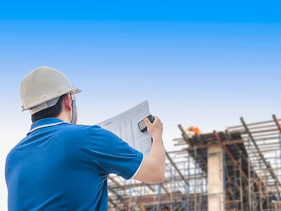 engineer-is-inspecting-his-work-in-building-construction-site.jpg