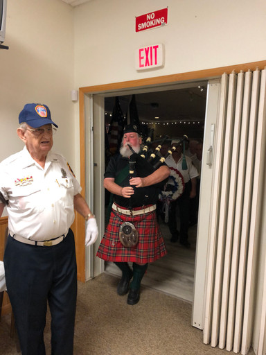 Bag Pipe leades members into ceremony