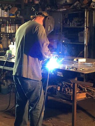 John creating steel sculptures.