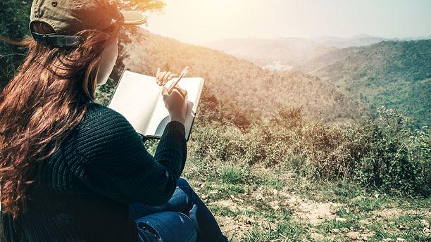 Women write notes Nature trails, mountai