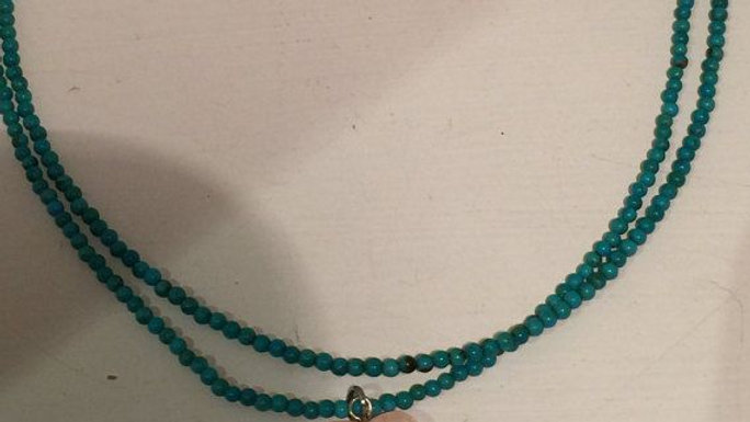 Two strand turquoise necklace with rose quartz drop and sterling silver clasp