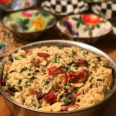Creamy Bowtie pasta with sun-dried tomatoes and peas