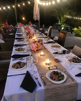 An outdoor table set for dinner