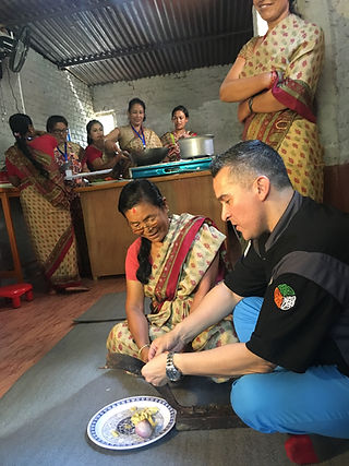 Chef Mark Tafoya learning from local village ladies in Nepal