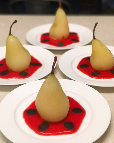 Poached Pears with Raspberry Coulis and Chocolate Sauce