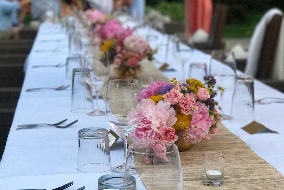 A table set for a backyard dinner