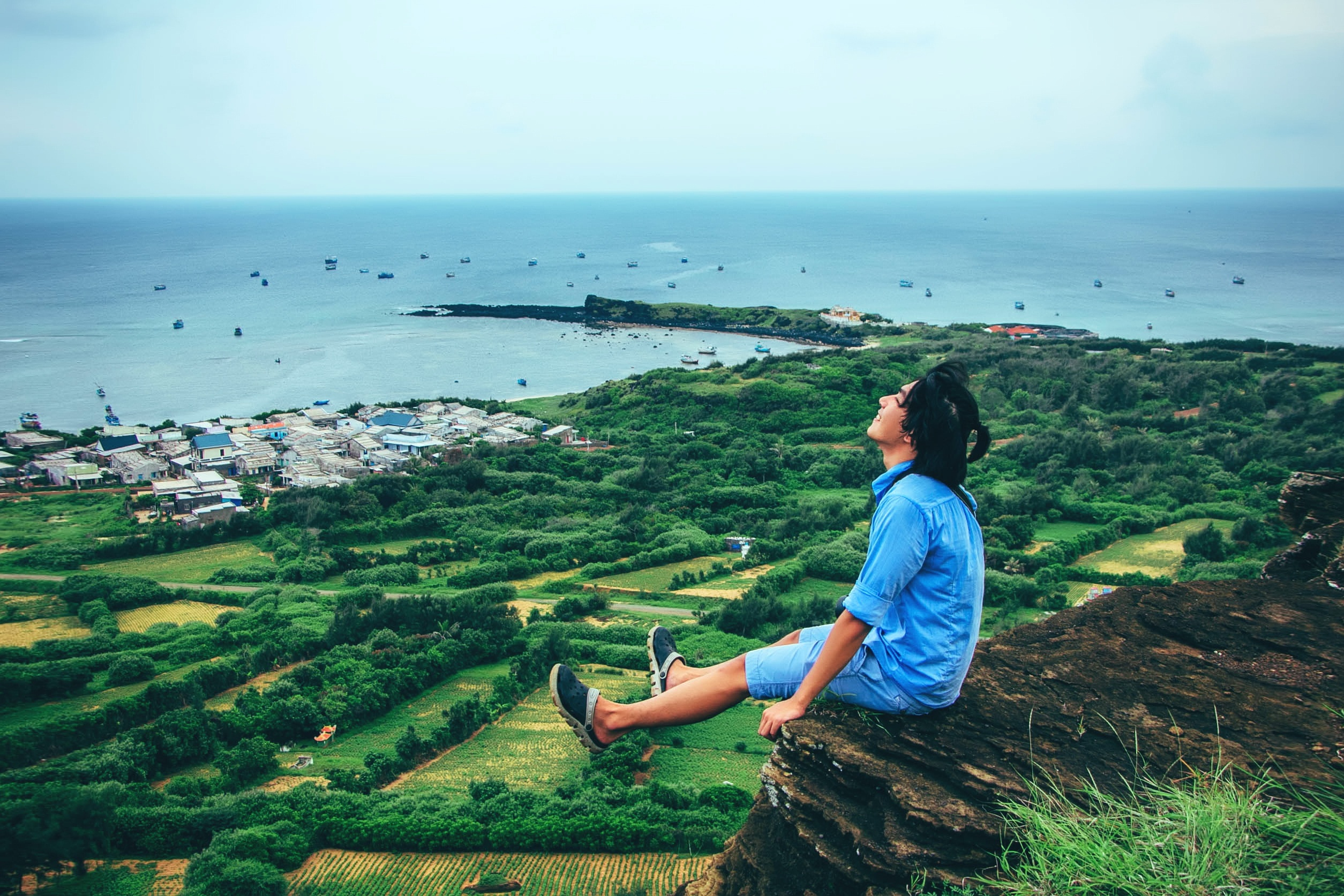 Canva - Man Sitting on Cliff