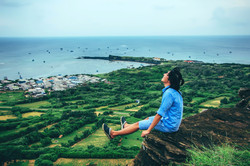 Canva - Man Sitting on Cliff