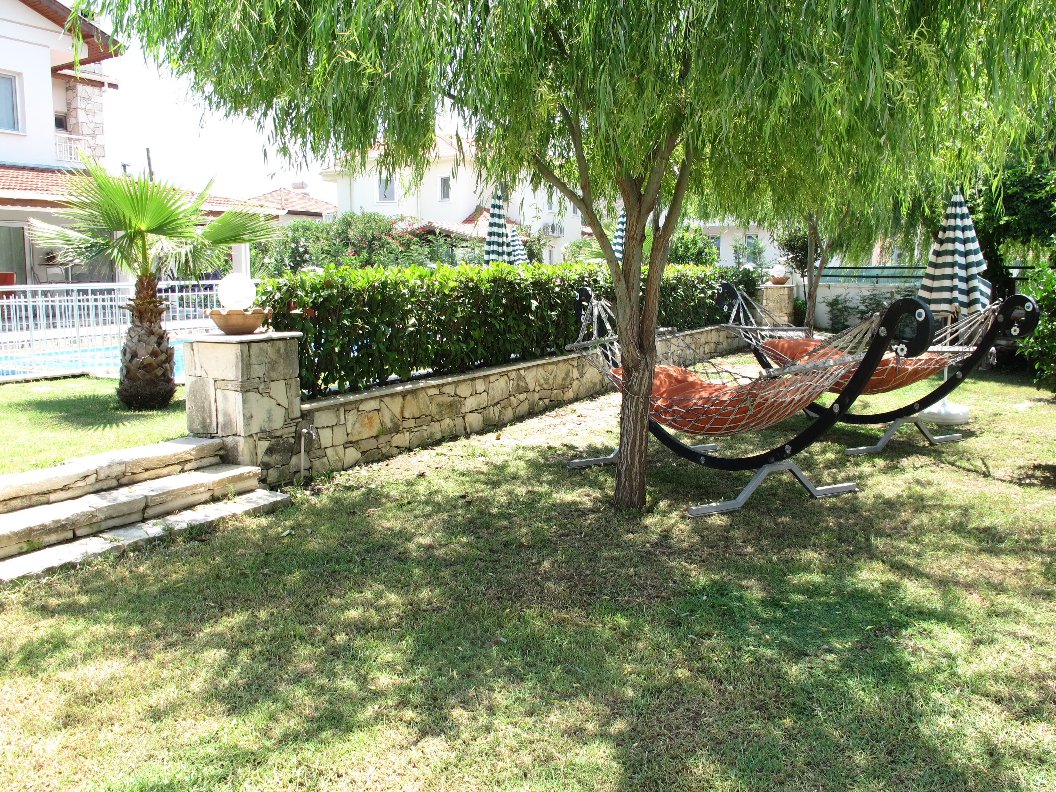 Hammocks and BBQ area.JPG