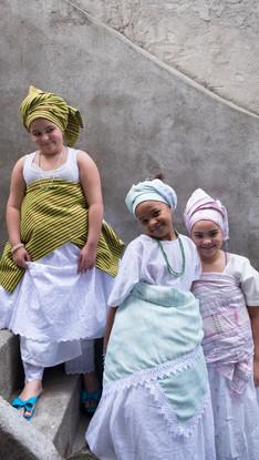 Smiling Girls in festive dresses
