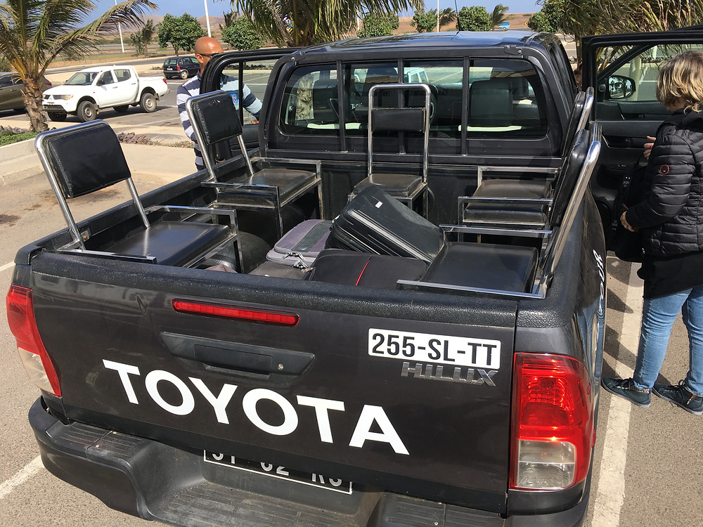 pickup-black-truck-shuttle-with-chairs-in-the-open-back